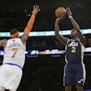 Utah Jazz's Marvin Williams (2) shoots over New York Knicks' Carmelo Anthony (7) during the first half of an NBA basketball game on Friday, March 7, 2014, in New York The Associated Press