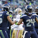 Seattle Seahawks running back Marshawn Lynch (24) is greeted by teammate Jermaine Kearse (15) after scoring a touchdown against the San Francisco 49ers in the second half of an NFL football game, Sunday, Dec. 14, 2014, in Seattle The Associated Press