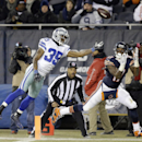 Chicago Bears wide receiver Alshon Jeffery (17) catches a touchdown pass thrown by quarterback Jay Cutler (6) against Dallas Cowboys cornerback Brandon Carr (39) during the second half of an NFL football game Thursday, Dec. 4, 2014, in Chicago The Associa