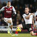 West Ham United s Ravel Morrison, left, controls the ball past Fulham s Scott Parker during their English Premier League soccer match in London, Saturday, Nov. 30, 2013. West Ham United won the match 3-0