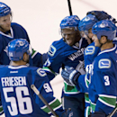 Vancouver Canucks Jordan Subban, center, celebrates his goal with teammates Linden Vey, from left, Alex Friesen, Hunter Shinkaruk and Kevin Bieksa during the first period of an NHL preseason hockey game in Vancouver, British Columbia, Tuesday, Sept. 23, 2