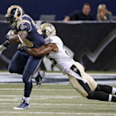St. Louis Rams running back Zac Stacy, left, drags New Orleans Saints free safety Rafael Bush along in the first quarter of a preseason NFL football game Friday, Aug. 8, 2014, in St. Louis The Associated Press