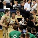Notre Dame players including Cameron Biedscheid (1) celebrate with fans following their 104-101 win against Louisville in the fifth overtime of their NCAA college basketball game, Saturday, Feb. 9, 2013, in South Bend, Ind. (AP Photo/Joe Raymond)