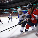 St. Louis Blues defenseman Kevin Shattenkirk (22) and Washington Capitals left wing Jason Chimera (25) battle for the puck on the boards, in the first period of an NHL hockey game, Sunday, Nov. 17, 2013, in Washington. The Capitals won 4-1 The Associated