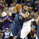 Minnesota Timberwolves forward Kevin Love (42) drives against Sacramento Kings defender Quincy Acy during the second half of an NBA basketball game in Sacramento, Calif., on Sunday, April 13, 2014. The Kings won 106-103 The Associated Press