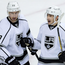 Los Angeles Kings' Slava Voynov, right, of Russia, celebrates his goal against the Vancouver Canucks, next to teammate Jeff Carter during the second period of an NHL hockey game Saturday, April 5, 2014, in Vancouver, British Columbia The Associated Press