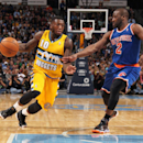Denver Nuggets guard Nate Robinson, left, works ball inside past New York Knicks guard Raymond Felton in the fourth quarter of the Nuggets' 97-95 victory in an NBA basketball game in Denver on Friday, Nov. 29, 2013 The Associated Press