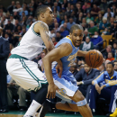 Denver Nuggets' Andre Miller (24) drives past Boston Celtics' Courtney Lee (11) in the second quarter of an NBA basketball game in Boston, Friday, Dec. 6, 2013 The Associated Press