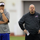 Buffalo Bills' head coach Doug Marrone, left, and defensive coordinator Mike Pettine, right, watch the rookie minicamp at the team's NFL football training facility in Orchard Park, N.Y., Friday, May 10, 2013. (AP Photo/Bill Wippert)