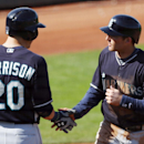 Seattle Mariners' Brad Miller, right, is congratulated by Logan Morrison after hitting a solo home run against the Cincinnati Reds during an exhibition baseball game in Goodyear, Ariz., Monday, March 3, 2014 The Associated Press