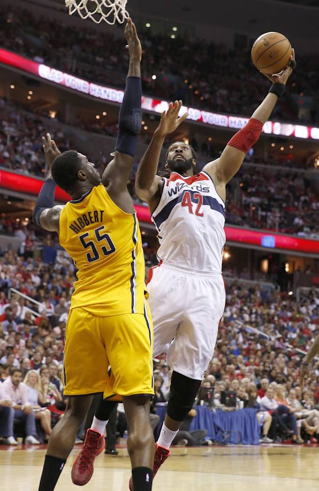 Washington Wizards forward Nene from Brazil (42) shoots past Indiana Pacers center Roy Hibbert (55) during the first half of Game 4 of an Eastern Conference semifinal NBA basketball playoff game in Washington, Sunday, May 11, 2014
