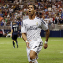 Real Madrid's Cristiano Ronaldo celebrates after scoring during the first half of an exhibition soccer match against Inter Milan Saturday, Aug. 10, 2013, at the Edward Jones Dome in St. Louis. (AP Photo/Jeff Roberson)