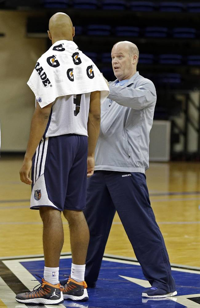 Charlotte Bobcats head coach Steve Clifford, right, talks with Gerald Henderson after a practice at the NBA basketball team's training camp in Asheville, N.C., Wednesday, Oct. 2, 2013