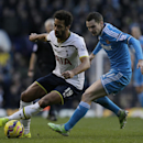 Tottenham Hotspur's Mousa Dembele, left, and Sunderland's Adam Johnson compete for the ball during the English Premier League soccer match between Tottenham Hotspur and Sunderland at White Heart Lane, London, England, Saturday, Jan. 17, 2015
