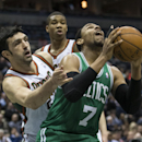 Milwaukee Bucks' Zaza Pachulia reaches in on Boston Celtics' Jared Sullinger (7) during the first half of an NBA basketball game, Monday, Feb. 10, 2014, in Milwaukee The Associated Press