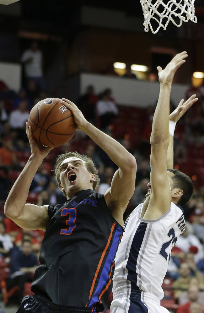 Boise State's Anthony Drmic shoots as Nevada's Michael Perez defends during the fist half of an NCAA college basketball game in the quarterfinals of the Mountain West Conference men's tournament Thursday, March 13, 2014, in Las Vegas