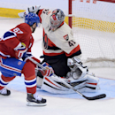 Montreal Canadiens forward Max Pacioretty puts the puck past Ottawa Senators goalie Craig Anderson during first period NHL hockey action in Ottawa on Friday, April 3, 2014 The Associated Press