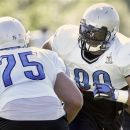 Detroit Lions defensive tackle Ndamukong Suh, right, goes up against defensive end Edmon McClam (75) during NFL football training camp on Sunday, July 29, 2012, in Allen Park, Mich. (AP Photo/Duane Burleson)