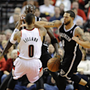Brooklyn Nets' Deron Williams (8) strips the ball from Portland Trail Blazers' Damian Lillard (0) during the first half of an NBA basketball game in Portland, Ore., Wednesday, Feb. 26, 2014 The Associated Press