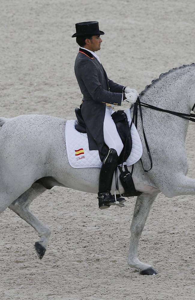 Jose Antonio Garcia Mena of Spain, riding Norte Lovera, during the first day of Dressage team competition at the FEI World Equestrian Games, at Michel d'Ornano stadium in Cean, western France, Monday, Aug. 25, 2014