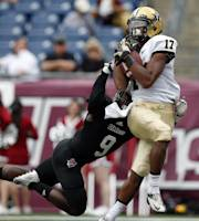 Vanderbilt wide receiver Jonathan Krause (17) catches a touchdown pass against Massachusetts defensive back Trey Dudley-Giles (9) in the first quarter of an NCAA college football game at Gillette Stadium in Foxborough, Mass., Saturday, Sept. 21, 2013. (AP Photo/Elise Amendola)
