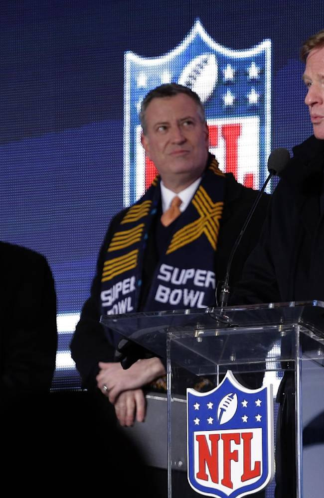 NFL comissioner Roger Goodell, right, speaks while New York City Mayor Bill de Blasio, center, and New York Gov. Andrew Cuomo, left, look on during a ceremony unveiling the Roman numerals for Super Bowl XLVIII on Super Bowl Boulevard Wednesday, Jan. 29, 2014, in New York. The Seattle Seahawks are scheduled to play the Denver Broncos in the NFL Super Bowl XLVIII football game on Sunday, Feb. 2, in East Rutherford, N.J