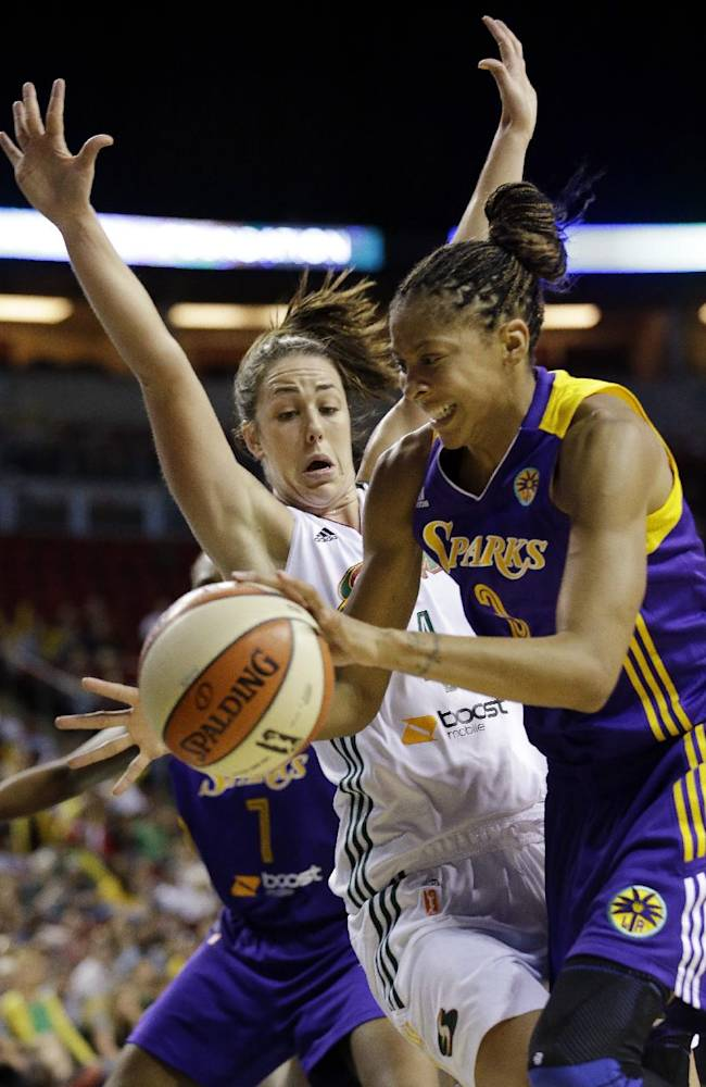 Los Angeles Sparks' Candace Parker, right, and Seattle Storm's Jenna O'Hea collide in the second half of a WNBA basketball game Friday, May 16, 2014, in Seattle. Parker led all scorers with 18 points and the Sparks won 80-69