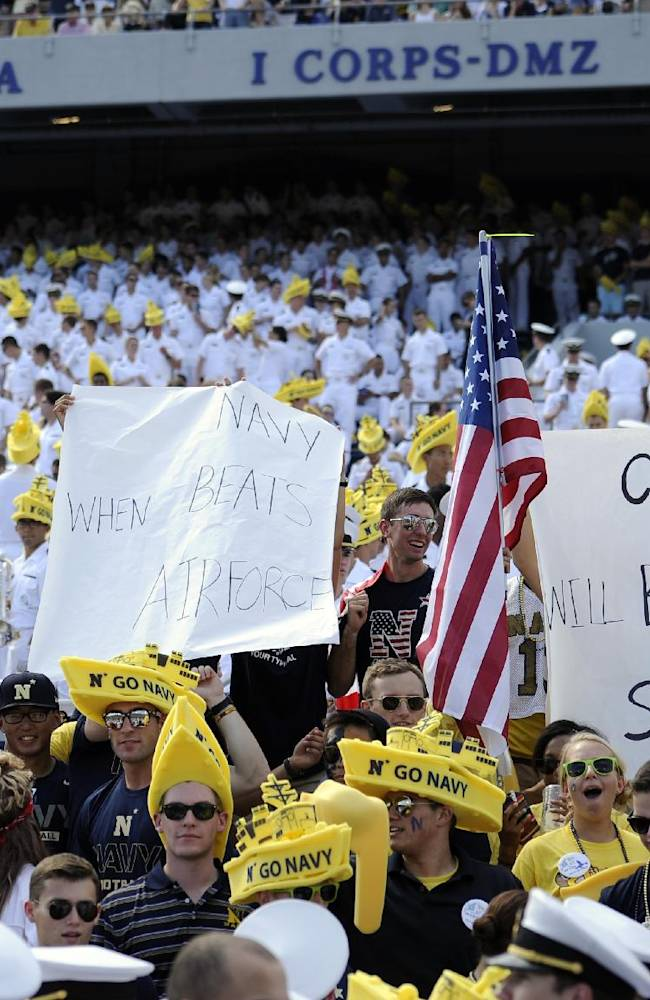 Fans display signs commenting on the government shutdown during the first half of an NCAA football game between Navy and Air Force, Saturday, Oct. 5, 2013, in Annapolis, Md