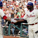 Philadelphia Phillies' Chase Utley, left and Ryan Howard celebrate Utley's solo home run during the eighth inning of a baseball game against the Miami Marlins, Sunday, April 13, 2014, in Philadelphia. The Phillies won 4-3 The Associated Press