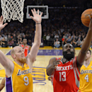 Houston Rockets guard James Harden, right, puts up a shot as Los Angeles Lakers center Chris Kaman defends during the first half of an NBA basketball game, Wednesday, Feb. 19, 2014, in Los Angeles The Associated Press