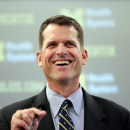 Michigan coach Jim Harbaugh aids traffic crash victims The Associated Press