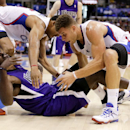 Sacramento Kings forward Patrick Patterson, bottom, battles Los Angeles Clippers forward Blake Griffin, right, and center Ryan Hollins for a loose ball during the first half of an NBA basketball game in Los Angeles, Saturday, Nov. 23, 2013 The Associated