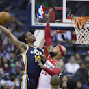 Utah Jazz point guard Alec Burks (10) drives to the basket against Washington Wizards power forward Drew Gooden (90) during the first half of an NBA basketball game on Wednesday, March 5, 2014, in Washington The Associated Press