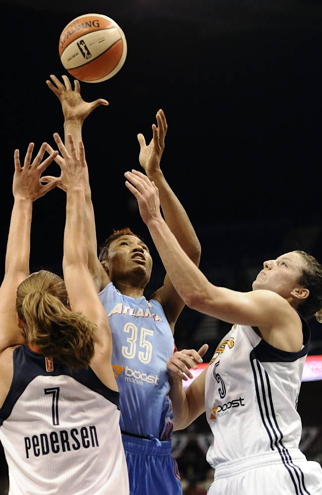 Atlanta Dream's Angel McCoughtry, center, drives to the basket as Connecticut Sun's Kayla Pedersen, left, and Kelsey Griffin, right, defend, during the first half of a WNBA basketball game in Uncasville, Conn., Wednesday, Sept. 11, 2013