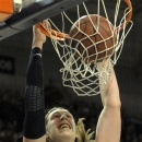 Gonzaga's Kelly Olynyk (13) puts in a dunk against Saint Mary's, in the first half of an NCAA college basketball game, Thursday, Jan. 10, 2013, in Spokane, Wash. (AP Photo/Jed Conklin)