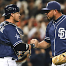 San Diego Padres relief pitcher Joaquin Benoit and catcher Yasmani Grandal congratulate each other after the Padres' 3-1 victory over the San Francisco Giants in a baseball game Saturday, April 19, 2014, in San Diego The Associated Press