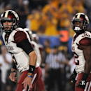 Oklahoma's Trevor Knight (9) and Samaje Perine (32) look for a call during the third quarter of an NCAA college football game against West Virginia in Morgantown, W.Va., on Saturday, Sept. 20, 2014. Oklahoma won 45-33. (AP Photo/Tyler Evert)