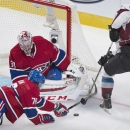 Montreal Canadiens goaltender Carey Price makes a save against Colorado Avalanche player Nathan MacKinnon, right, as Canadiens' P.K. Subban defends during the third period of an NHL hockey game, Saturday, Oct. 18, 2014 in Montreal The Associated Press