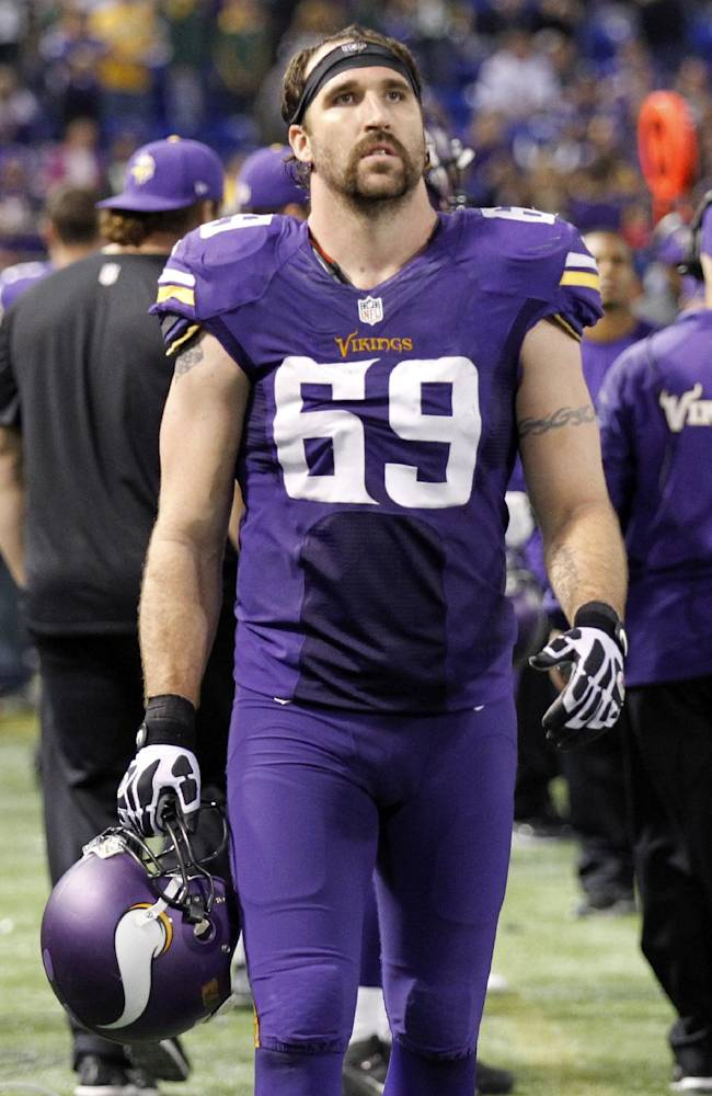 In this Oct. 27, 2013, file photo, Minnesota Vikings defensive end Jared Allen walks along the sidelines during the final minutes in the second half of an NFL football game against the Green Bay Packers in Minneapolis. Allen's name was bandied about in trade speculation until the NFL deadline passed on Tuesday afternoon, so the four-time first-team All-Pro pick will finish the final year of his contract with Minnesota