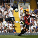 Tottenham Hotspur's Christian Eriksen, left, competes for the ball with Queens Park Rangers' Armand Traore during their English Premier League soccer match at White Hart Lane, London, Sunday, Aug. 24, 2014