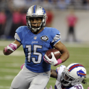 Detroit Lions wide receiver Golden Tate (15) avoids a tackle by Buffalo Bills defensive back Nickell Robey (37) during the third quarter of an NFL football game Sunday, Oct. 5, 2014, in Detroit The Associated Press