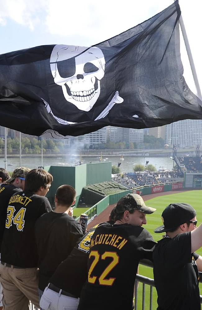 Pittsburgh Pirates fans wave a Jolly Roger flag as they stand in the left field rotunda before Game 3 of a National League division baseball series between the Pirates and St. Louis Cardinals on Sunday, Oct. 6, 2013, in Pittsburgh