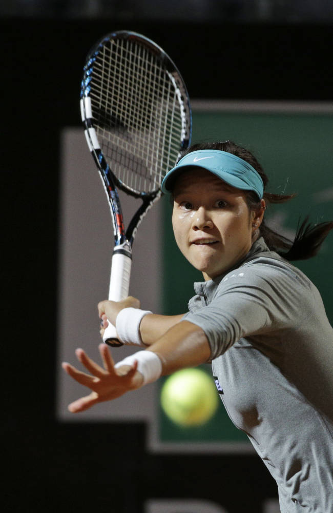 China's Na Li returns the ball to Australia's Casey Dellacqua at the Italian Open tennis tournament, in Rome, Tuesday, May 13, 2014