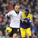 Fulham s Dimitar Berbatov (left) and Swansea City s Roland Lamah battle for the ball during their English Premier League soccer match at Fulham, south-west London, England, Saturday, Nov 23, 2013. (AP Photo / Nigel French, PA)