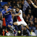 PSG's Lucas, right, and Chelsea's Frank Lampard vie for the ball during the Champions League second leg quarterfinal soccer match between Chelsea and Paris Saint-Germain at Stamford Bridge Stadium in London, Tuesday, April 8, 2014