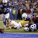 Washington Redskins tight end Jordan Reed reaches in to the end zone as he's stopped by Indianapolis Colts inside linebacker D'Qwell Jackson, top, and free safety Sergio Brown during the second half of an NFL football game Sunday, Nov. 30, 2014, in Indian