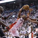Toronto Raptors' Kyle Lowry is fouled by Brooklyn Nets' Kevin Garnett, left, as Nets' Alan Anderson watches during the first half of Game 1 of an opening-round NBA basketball playoff series, in Toronto on Saturday, April 19, 2014 The Associated Press