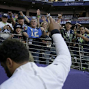 Seattle Seahawks quarterback Russell Wilson gestures toward fans as he walks of the field before the NFL Super Bowl XLIX football game against the New England Patriots on Sunday, Feb. 1, 2015, in Glendale, Ariz The Associated Press