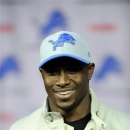 Reggie Bush speaks at a news conference after agreeing to a four-year deal with the Detroit Lions NFL football team, Wednesday, March 13, 2013 in Detroit.  (AP Photo/Detroit News, John T. Greilick)