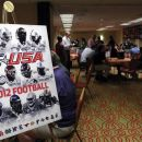 Reporters, coaches and players gather around tables to talk about the upcoming football season at the NCAA college football Conference USA media day on Wednesday, July 25, 2012, in Dallas. (AP Photo/John F. Rhodes)